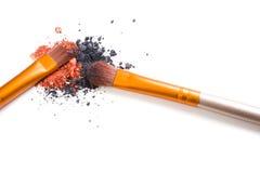 Professional makeup brushes set and loose powder eyeshadows isol Royalty Free Stock Photos