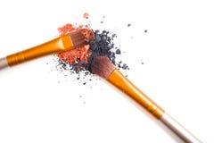 Professional makeup brushes set and loose powder eyeshadows isol Royalty Free Stock Photo