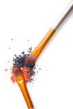 Professional makeup brushes set and loose powder eyeshadows isol Royalty Free Stock Image