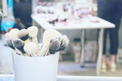 Professional makeup brushes and tools on stand. Makeup artist, f royalty free stock photos