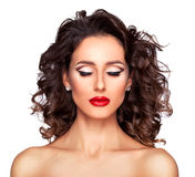 Professional makeup and hairstyle. Photo of beautiful nude fashion female model with professional makeup and hairstyle on white background Royalty Free Stock Images