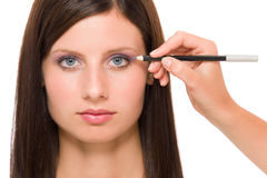 Professional makeup model artist make eye lines Royalty Free Stock Photography