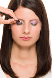 Professional makeup model artist make eye lines Stock Photos