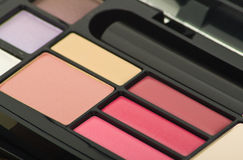 Professional makeup palette. Lipstick, powder, eye shadow stock photos