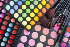 Professional makeup palettes and brushes Royalty Free Stock Photos