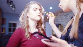 Professional makeup process stock video footage