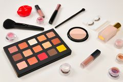 Professional makeup products with cosmetic beauty products, eye shadows, pigments, lipsticks, brushes and tools. Space for text or. Design. Top view stock photography