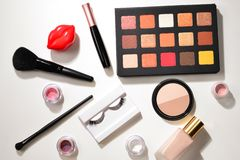 Professional makeup products with cosmetic beauty products, eye shadows, pigments, lipsticks, brushes and tools. Space for text or. Design. Top view royalty free stock photography