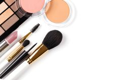 Professional makeup tools. Brushes rouge eye shadows palette flat lay composition copy space stock photography