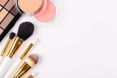 Professional makeup tools. Brushes rouge eye shadows palette flat lay composition copy space stock images