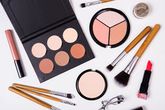 Professional makeup tools, flatlay on white background. Professional makeup brushes and tools, make-up products kit, flatlay on white background Stock Image