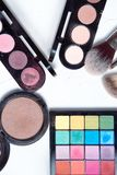 Professional makeup tools on white wooden background. Highlighter, sculptor, powder for sculpting, kabuki brush , brush for blush, brush for sculpting, fixture Royalty Free Stock Image