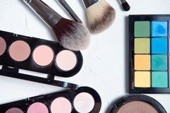 Professional makeup tools on white wooden background. Highlighter, sculptor, powder for sculpting, kabuki brush , brush for blush, brush for sculpting, fixture Royalty Free Stock Photography
