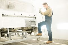 Mechanic Painting Car Body stock image