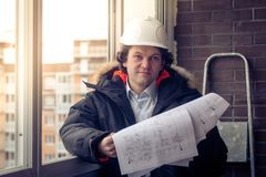 Professional male construction businessman with his blueprints. Soft focus, toned. Royalty Free Stock Photos