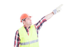 Professional male constructor poiting finger up Royalty Free Stock Photo
