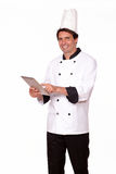 Professional male cook working on tablet pc Royalty Free Stock Photos