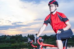 Professional Male Cyclist on the Bike. Equipped with Summer Bike Outfit. Outdoor Shot. Horizontal Image Royalty Free Stock Photo