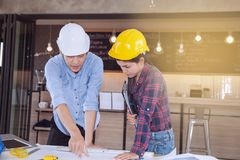 Professional male and female engineers working and discuss with Stock Photo