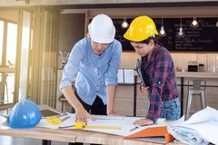 Professional male and female engineers working and discuss with Royalty Free Stock Image