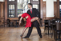 Professional Male And Female Tango Dancers Performing In Restaur. Full length of professional male and female tango dancers performing in restaurant Stock Photos