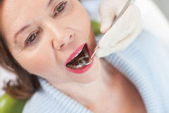 Professional male orthodontist is treating his patient Royalty Free Stock Images
