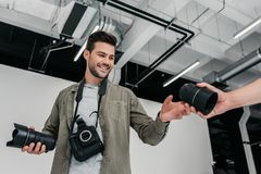 Photographer with camera and lenses Royalty Free Stock Photos