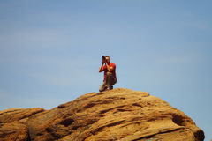 Professional male photographer takes photos on the mountain Stock Images