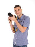 Professional male photographer taking picture Royalty Free Stock Image