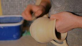 Professional male potter working in workshop stock video