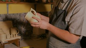 Professional male potter working in workshop stock video footage