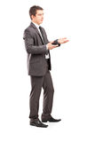Professional male shot during a conversation. Full length portrait of a professional male shot during a conversation isolated on white background Royalty Free Stock Images