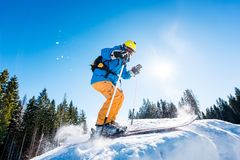 Skier skiing in the mountains. Professional male skier skiing on fresh snow in the mountains on a sunny beautiful day extreme fun happiness activity lifestyle Stock Photo
