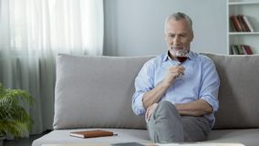 Professional male sommelier enjoying perfect flavor of red wine, hobby. Stock footage Stock Image