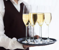Professional male waiter in uniform serving champagne. DOF. Stock Images