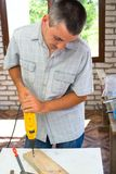 Professional man with drill Stock Photography