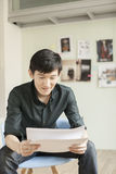 Professional Man Looking at Papers in Office Royalty Free Stock Photography
