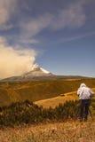 Professional man photographer posing Cotopaxi volcano Stock Photo