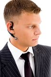 Professional man posing with bluetooth Stock Image