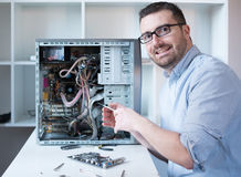 Professional man repairing and assembling a computer Royalty Free Stock Photo