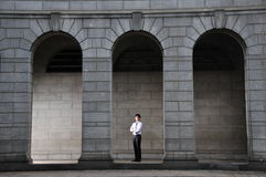 Professional Man standing among arches Stock Image