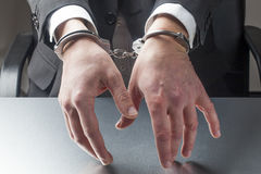 Professional man taken in custody with hands in focus Royalty Free Stock Images