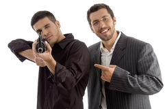 Professional man targeting someone with gun Royalty Free Stock Images
