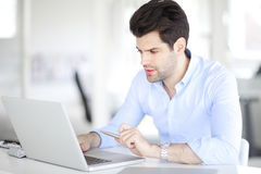 Professional man using laptop Stock Photo