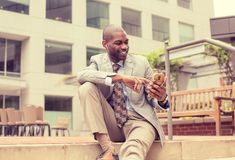Professional man using smart phone listening to music outdoors Royalty Free Stock Photography