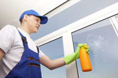 Professional man washes window Stock Photo
