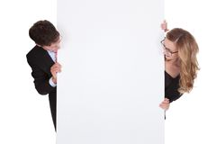 Professional man and woman with a blank sign Royalty Free Stock Photography