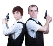 Professional man and woman with guns stock images