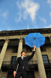 Professional Man working holding a blue umbrella Royalty Free Stock Images