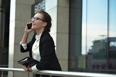 Professional manager lady with phone and documents. Royalty Free Stock Images